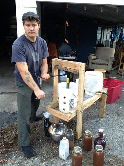 a home made cider press in operation